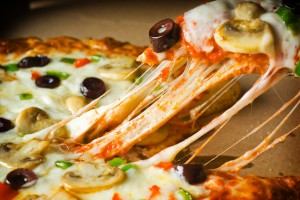 Slice of Vegetable Pizza with Melty Cheese