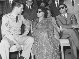 Elvis Presley entertains King Mehendra and Queen Ratna of Nepal on a movie set in Los Angeles, Calif., 1960